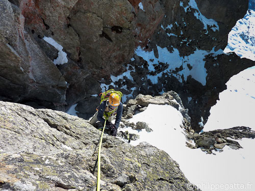 Anna in the rocky section of West Couloir of Gelas (© Philippe Gatta)