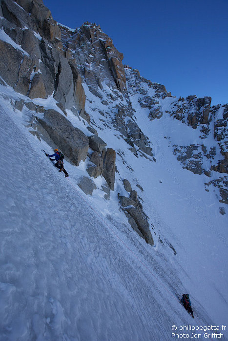 Philippe and Carine high up in Grande Rocheuse North Face (Photo J. Griffith)