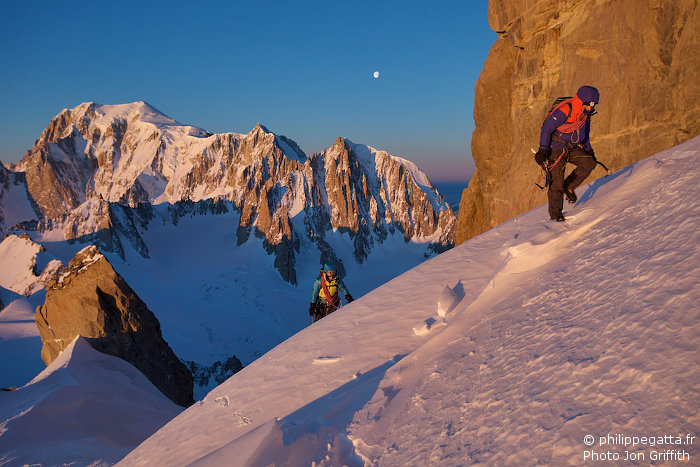 Sunrise at the base of Dent du Geant. The moon over Mont Blanc du Tacul. Mont Maudit and Mont Blanc on the left  (Photo J. Griffith)