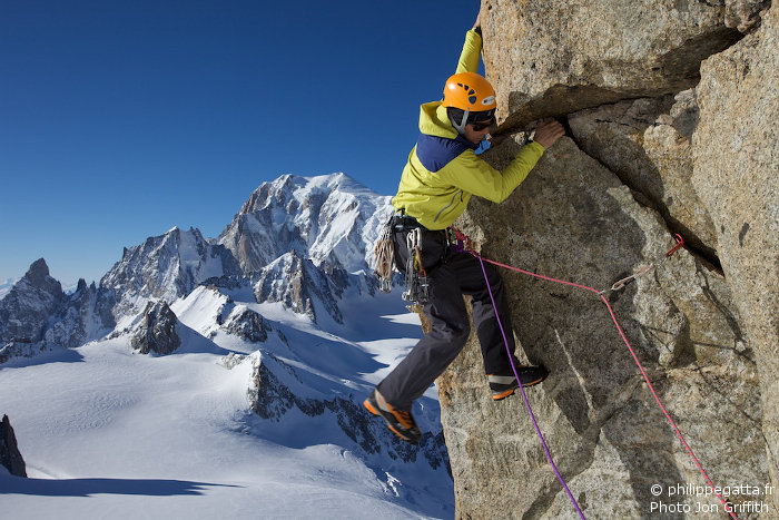 Philippe climbing a pinnacle rock (Photo J. Griffith)