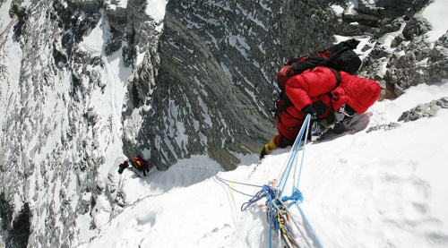 Kevin climbing down Everest 2nd step, reaching the top of the ladder (Jamie McGuiness)