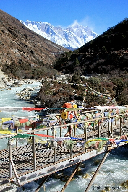 Philippe Gatta on the bridge crossing the Imja Khola before climbing 700 m up to Ama Dablam BC (� A. Gatta)